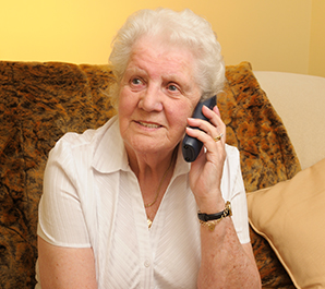 Elderly woman on mobile phone.