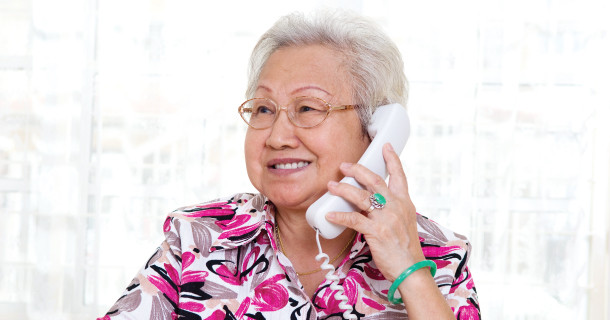 Older woman smiling while talking on the phone